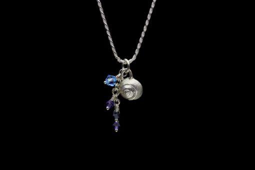 Alohi Kai snail charm crystals hang close