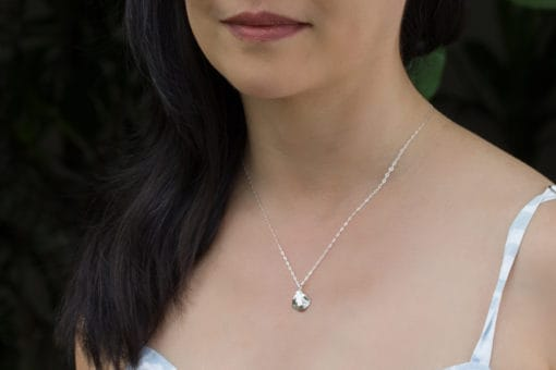 baby stingray necklace on model
