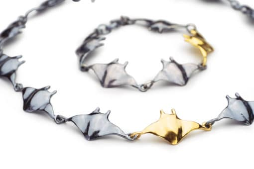 manta link necklace + bracelet in black gold close
